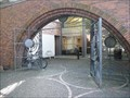 Image for Untitled - Bronze gates integrated with brick wall entrance to the library