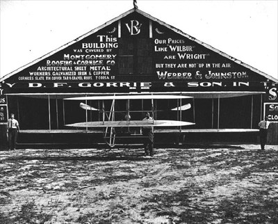 View of the 1910 hangar and Flyer.