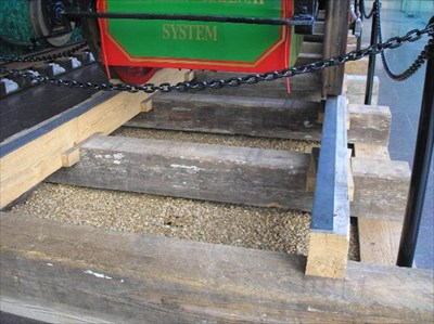 A close-up view of the iron strap attached to the timber stringer.