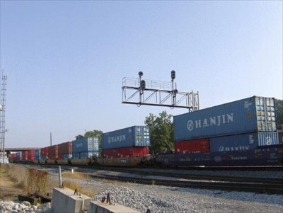 Hauling freight containers.
