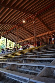 The wide wooden bench seating at the Painted Pony Rodeo gives spectators a great view of the action and quick access to food and drink at the concourse behind the top row.