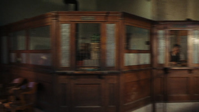 It's a blurry snapshot from the movie because the camera pans so quickly, but it's enough to catch a glimpse of the teller windows inside.