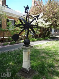 The sundial is in the gardens at Chatham Manor, seen in background.