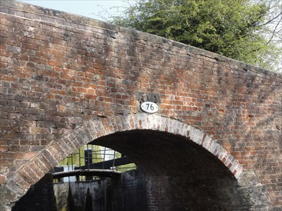 The attached lock and gates can be seen through the bridge arch.