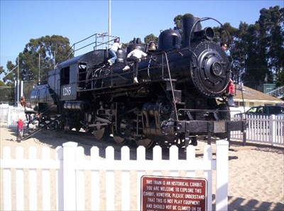 """Sign on fence euphamistically asserts that the locomotive is for """"historical"""" use only...but you're welcome to climb all over it if you like ;)"""