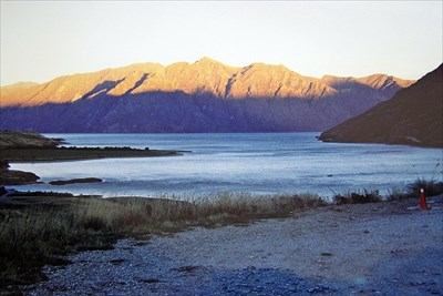 Sun going down on the mountains. The Neck, Lake Hawea.