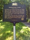 A historical marker describing the view.