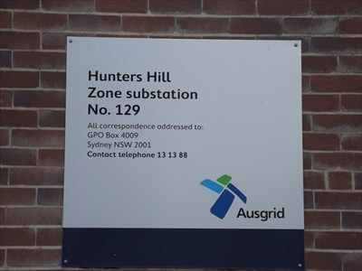 Close up of the signage from Ausgrid, the electrical supplier which states that it is 'Hunters Hill'.