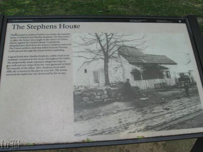 An interpretive sign with an old photo of the Stephens House