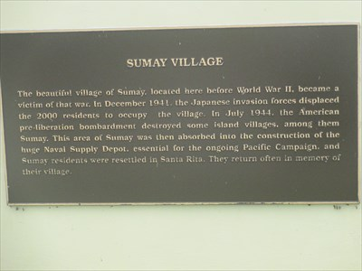 The beautiful village of Sumay, located here before WWII, became a victim of that war. In December 1941, the Japanese invasion forces displaced the 2000 residents to occupy the village. In July 1944, the American pre-liberation bombardment destroyed some island villages, among them Sumay. This area of Sumay was then absorbed into the construction of the huge Naval Supply Depot, essential for the ongoing Pacific Campaign, and Sumay residents were resettled in Santa Rita. They return often in memory of their village.