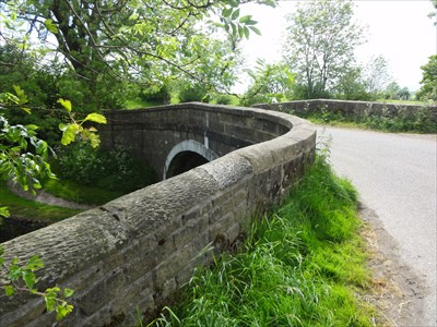 As well as carrying the road, the towpath crosses from this nearside and the loops round to pass under the bridge on the other side