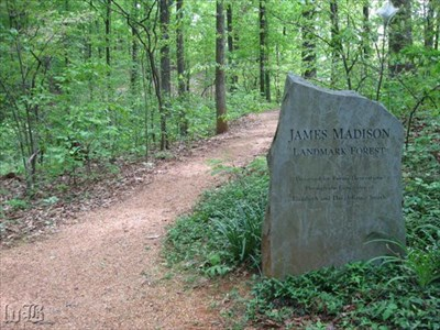 A boulder marks the entrance into the James Madison Landmark Forest or Montpelier Forest.