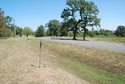 In the background you can see the water access pipe at the same relative distance from the road.  On the other side of the road is the intersection of Wells Lake Road with Custer Blvd.