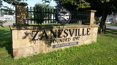 Zanesville sign on the west end of town
