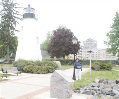 geotrooperz-gm at the Havre de Grace -- War of 1812 historical marker with Concord Point Light House in the background.