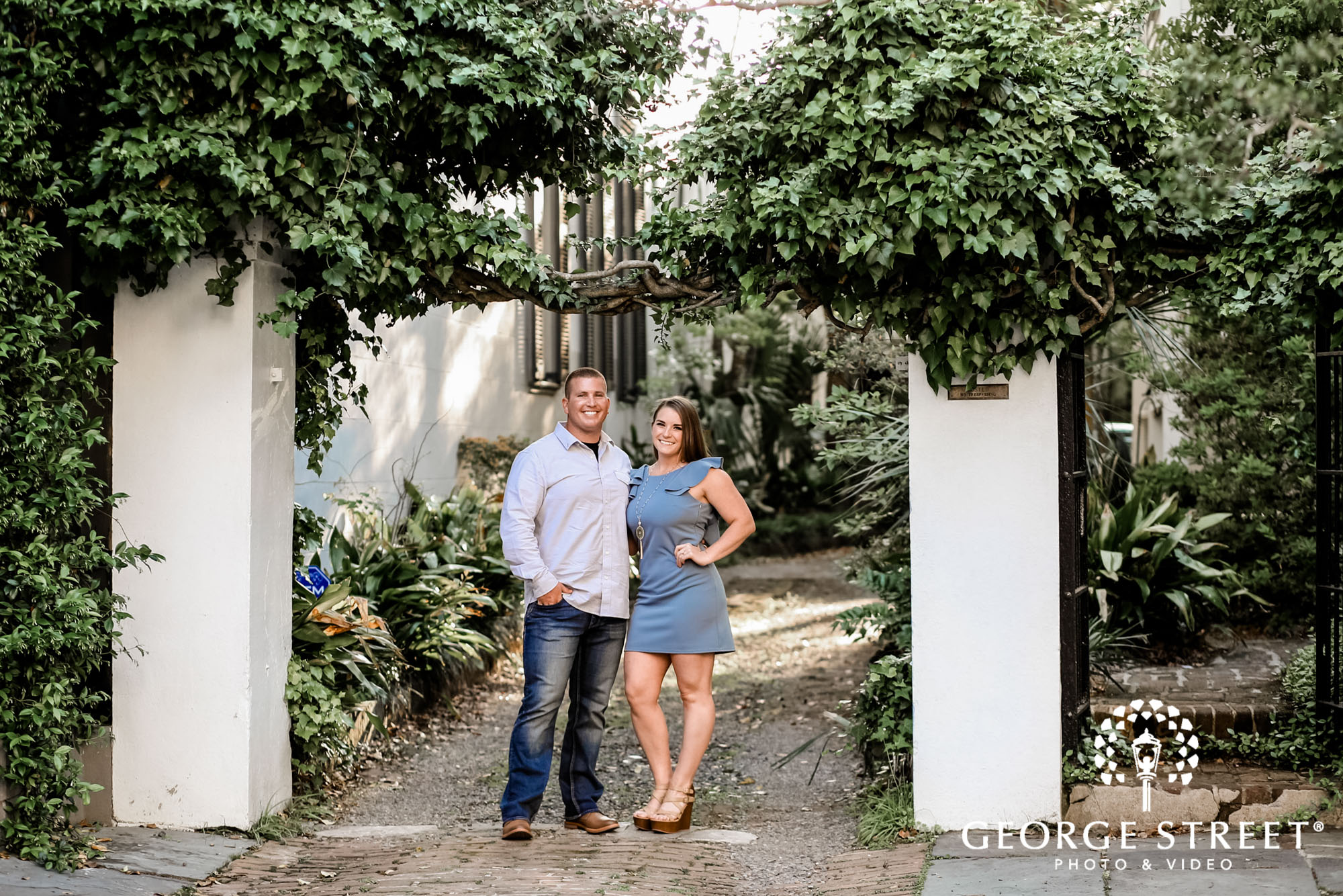 cheery couple at white point garden in charleston engagement photos 2