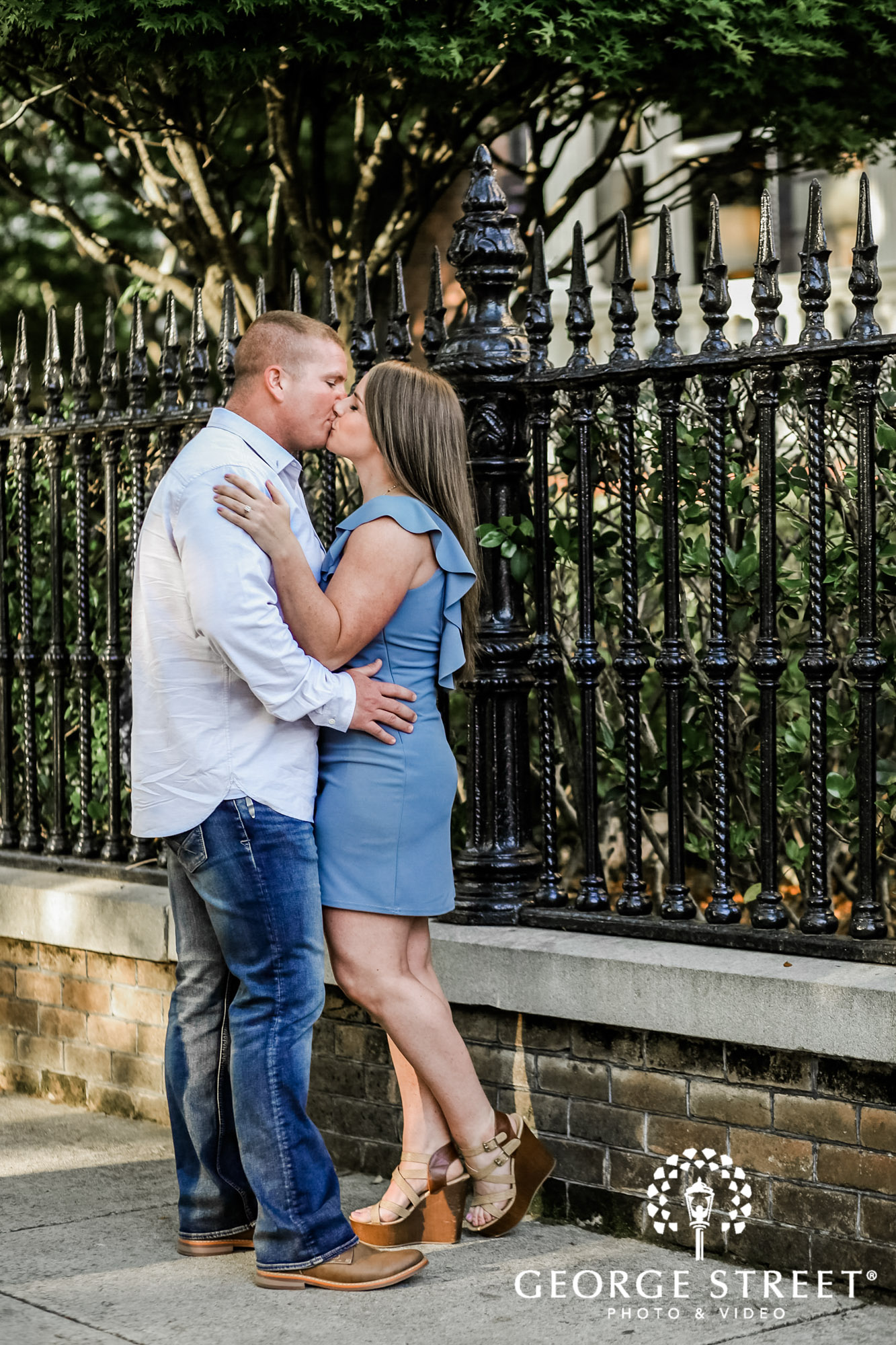 happy couple on pathway to white point garden in charleston engagement photos 3