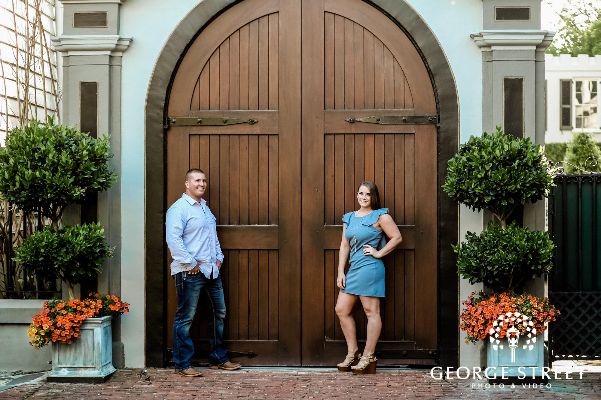 joyful couple with gateway of white point garden engagement photography