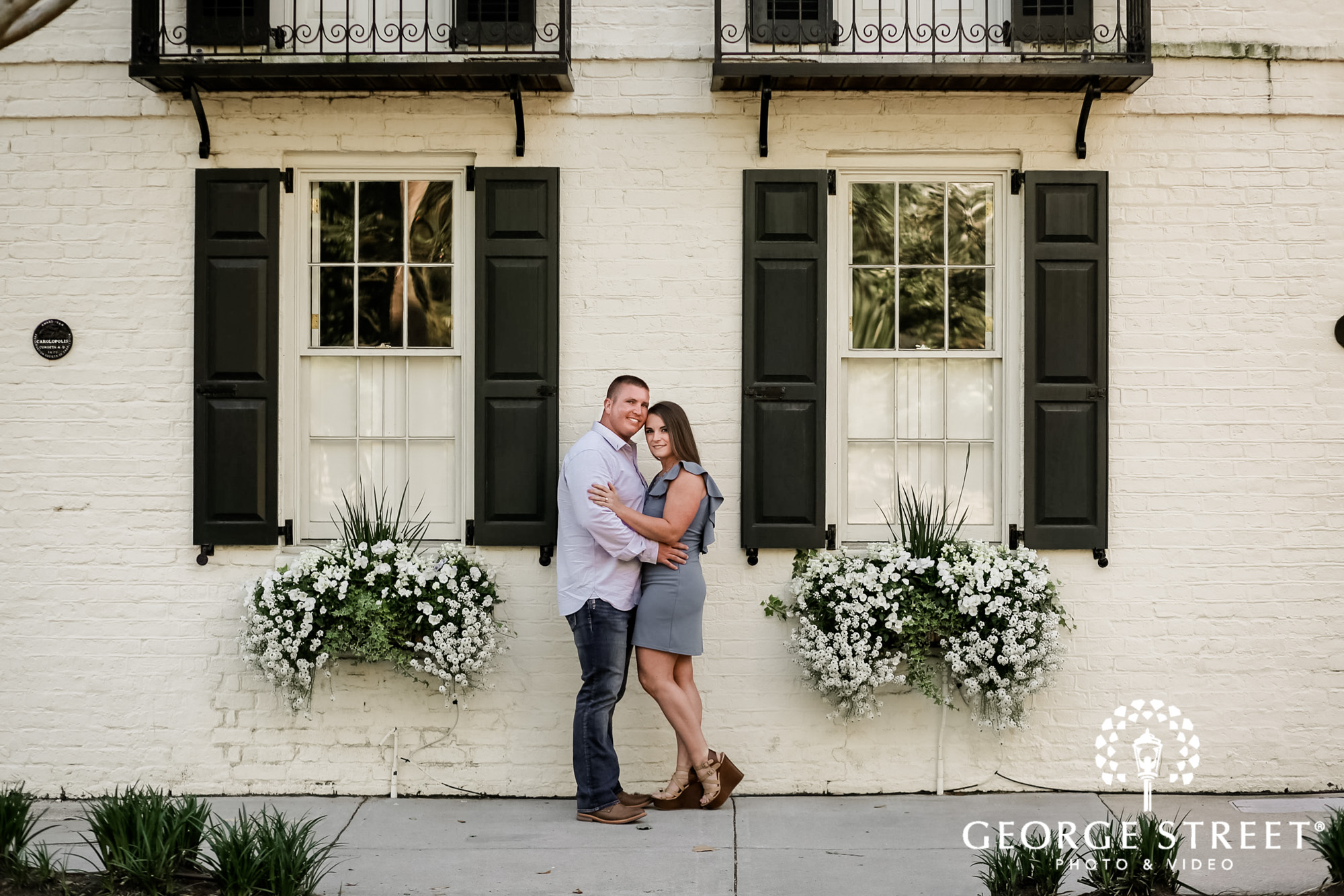 lovely couple infront of house in charleston engagement photography 2