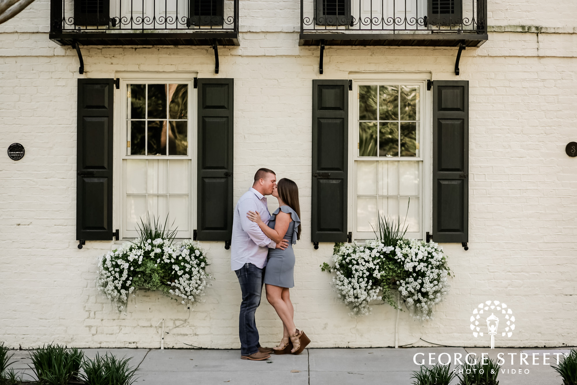 lovely couple infront of house in charleston engagement photography
