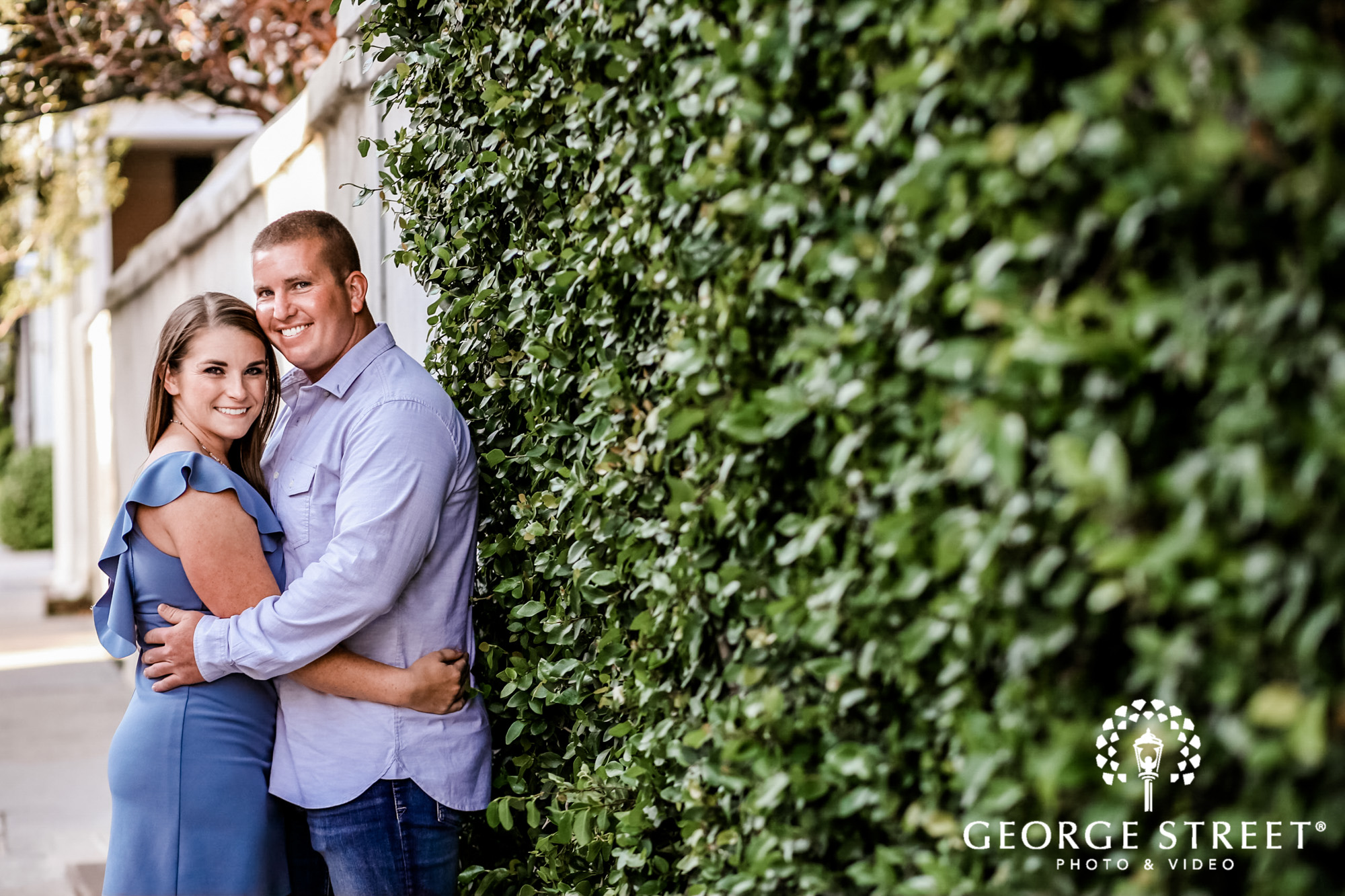 passionate couple near vine wall engagement photography 2
