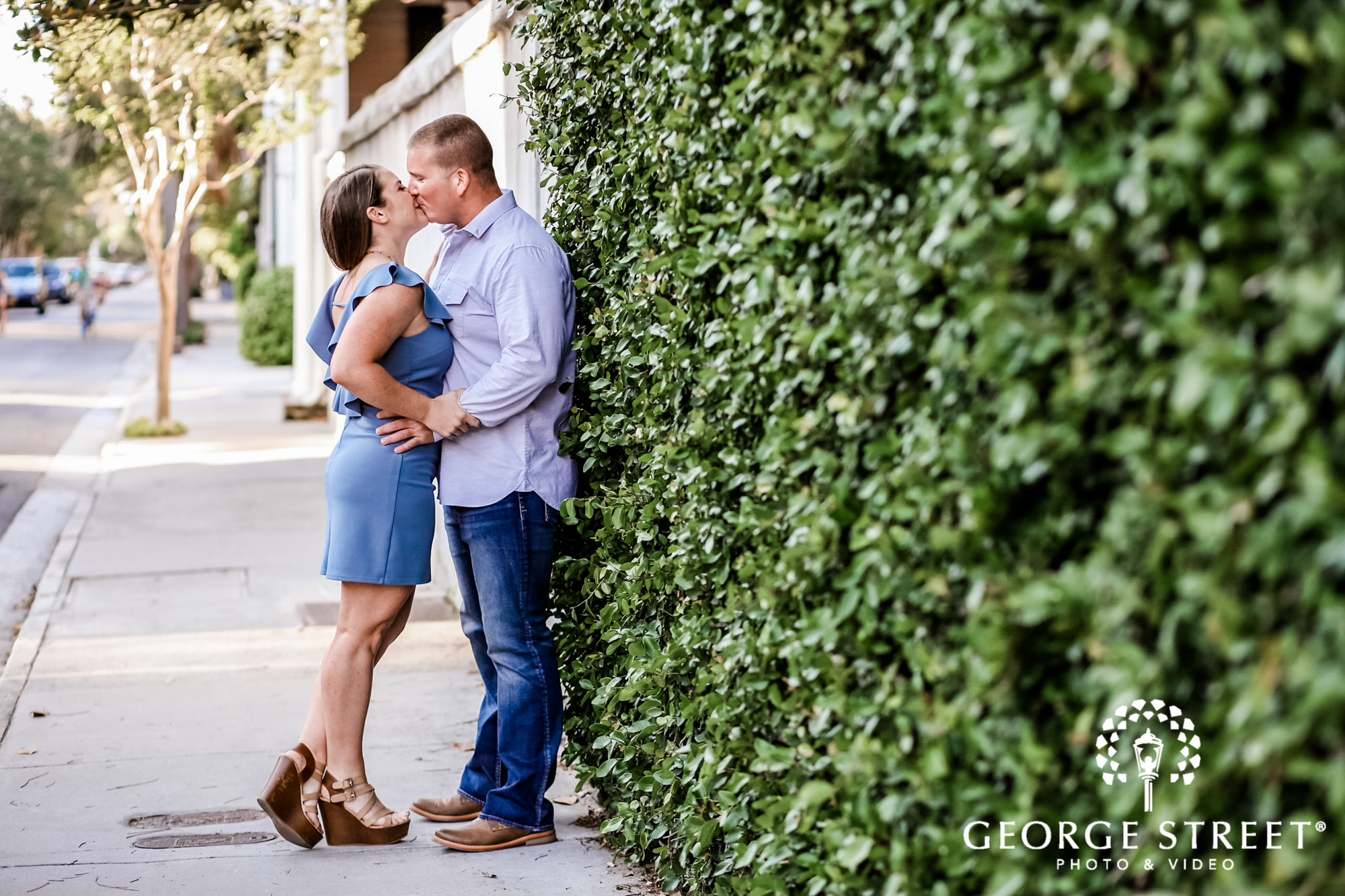 passionate couple near vine wall engagement photography