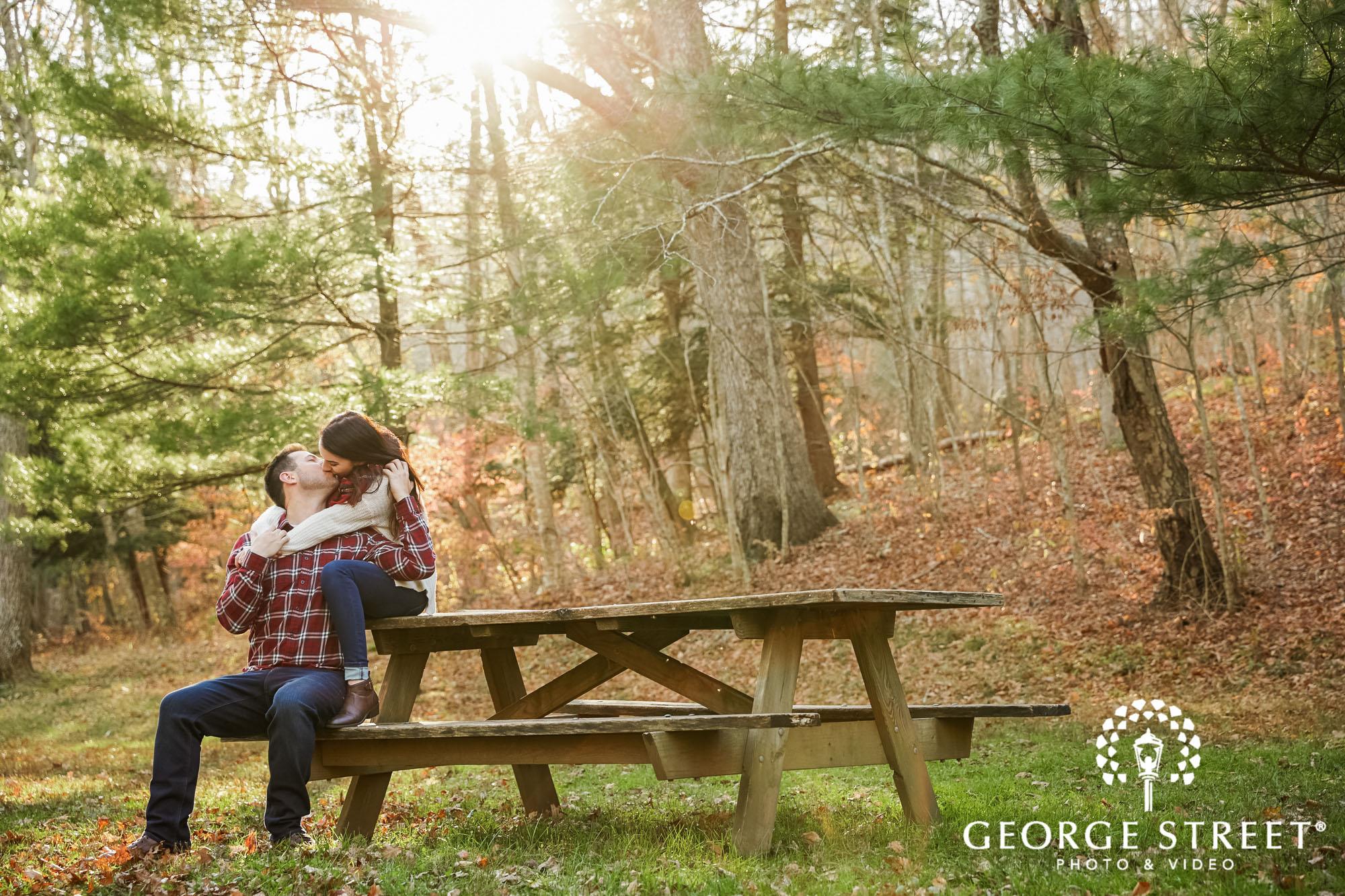 adorable couple on bench at devils hopyard state park in hartford