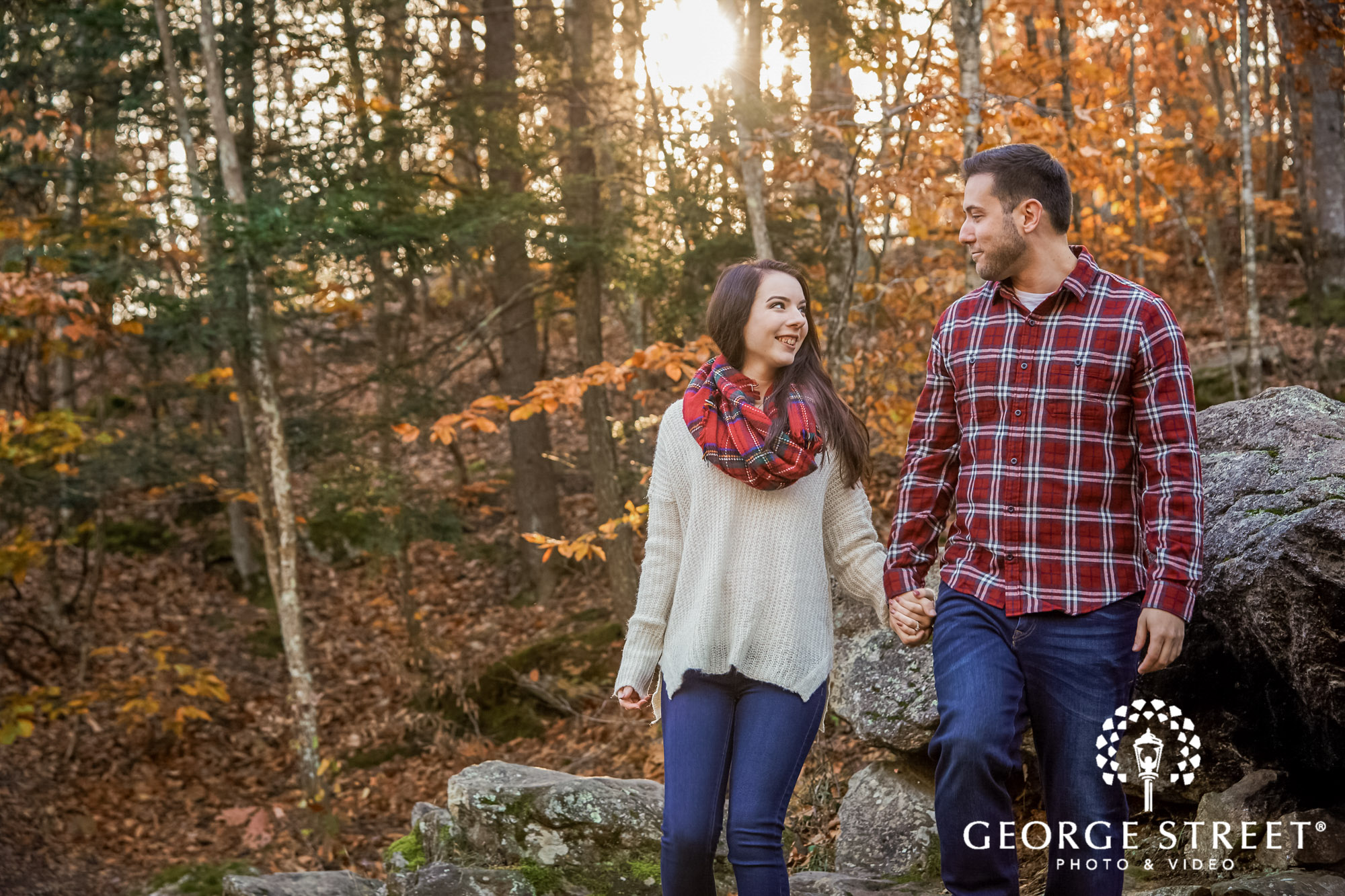 charming couple in park engagement photo