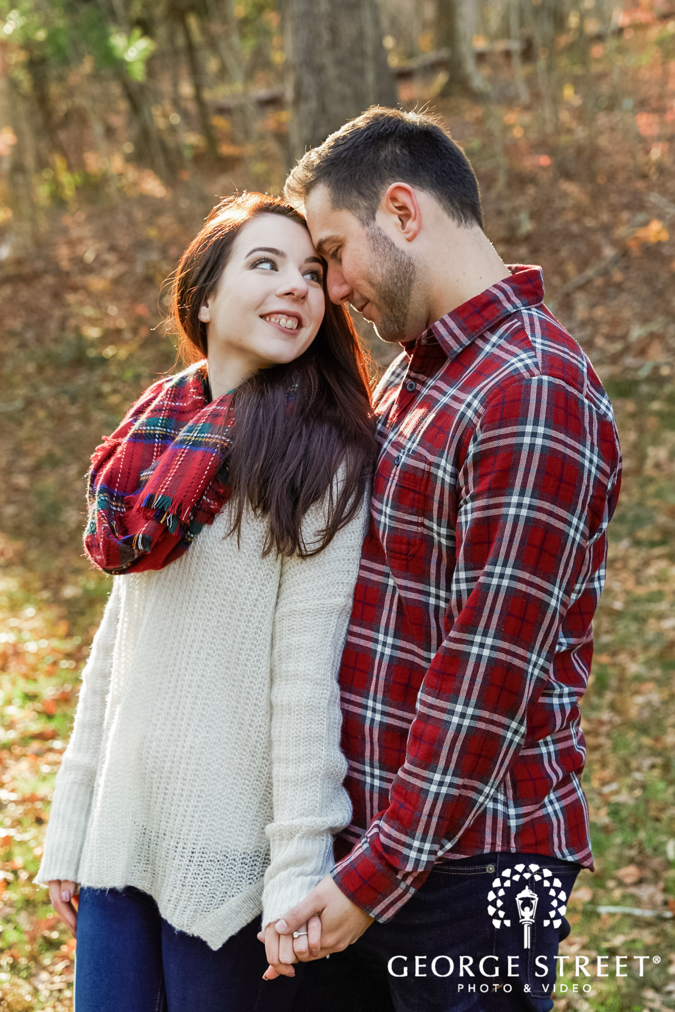 cute couple in lawn engagement photo