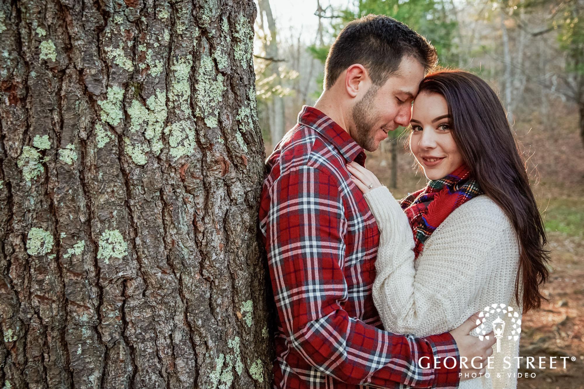 graceful couple near woods engagement photo