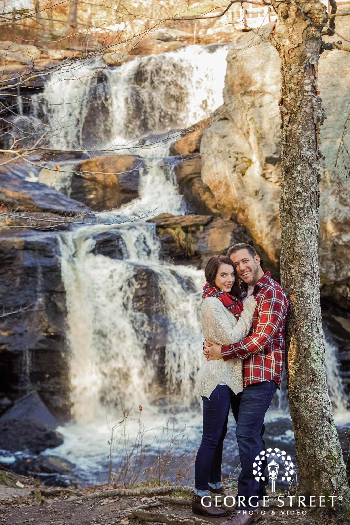 happy bride and groom in front of waterfall engagement photography