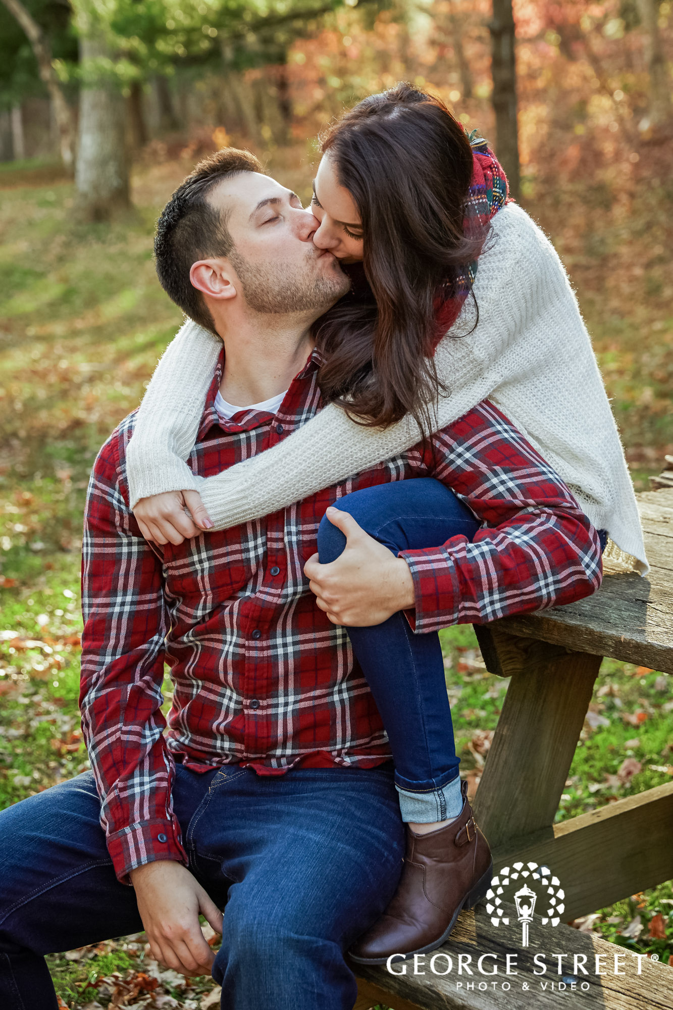 intimate couple on bench engagement photography