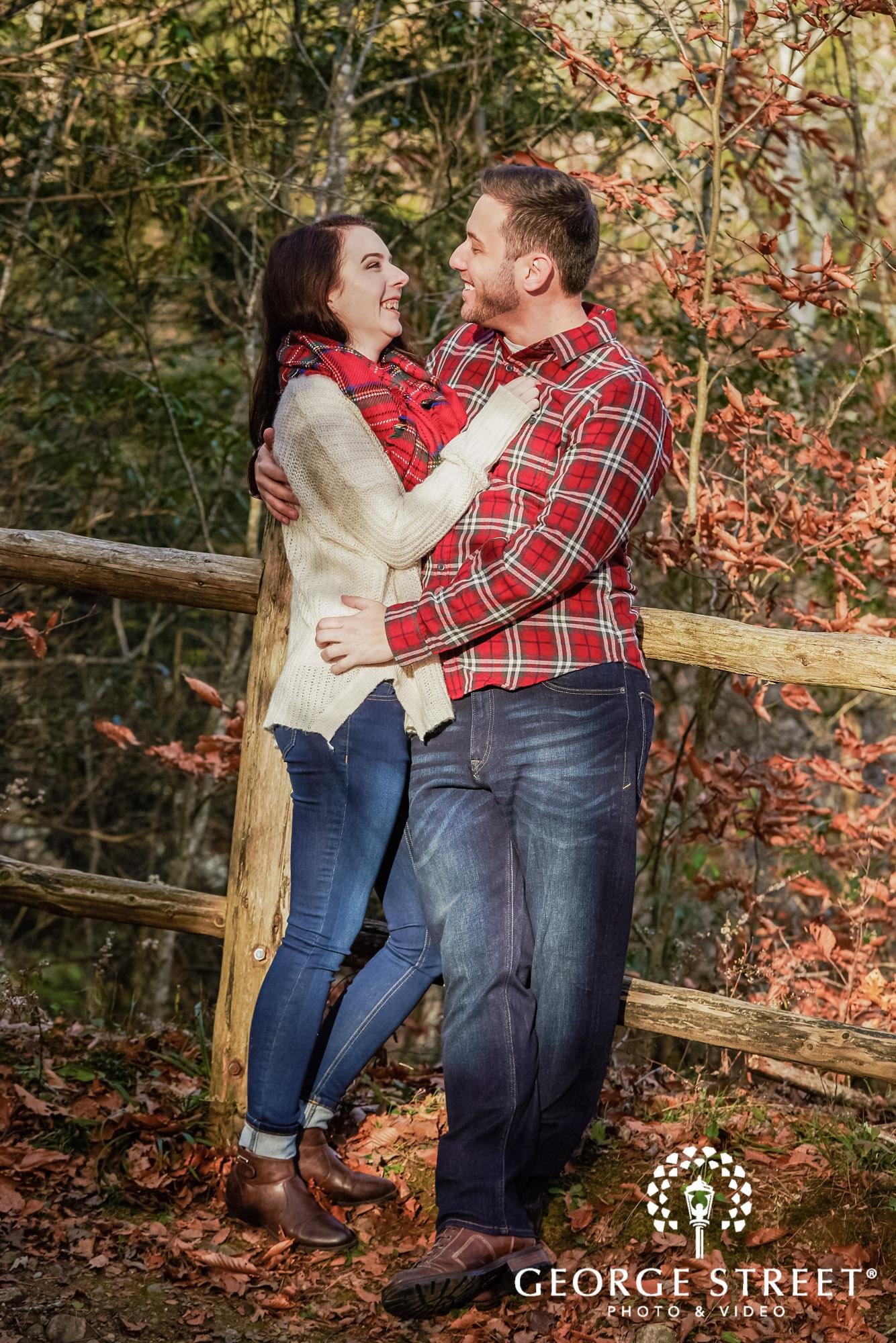 joyful couple on track engagement photo