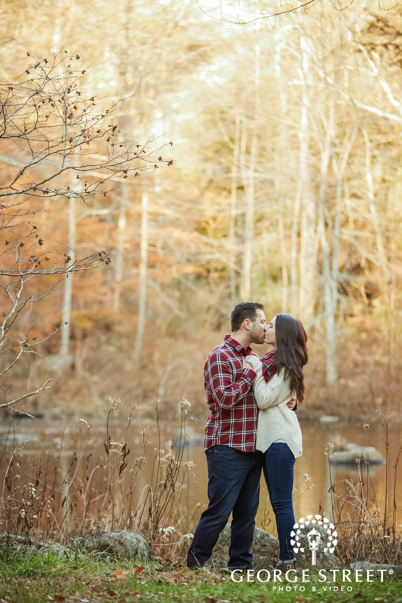 romantic couple near lake engagement photography