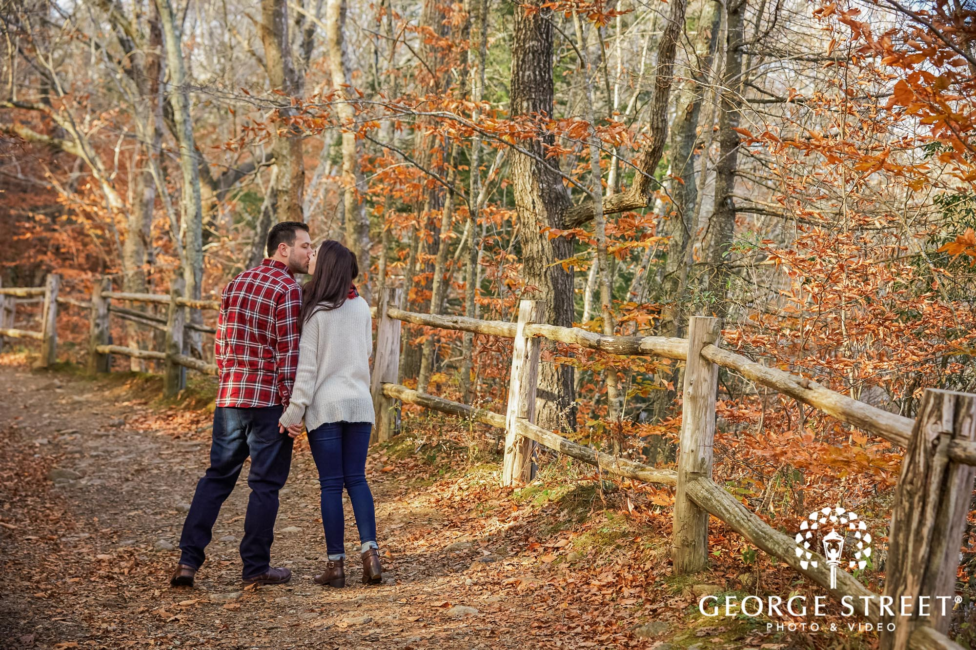 romantic couple on pathway at devils hopyard state park in hartford