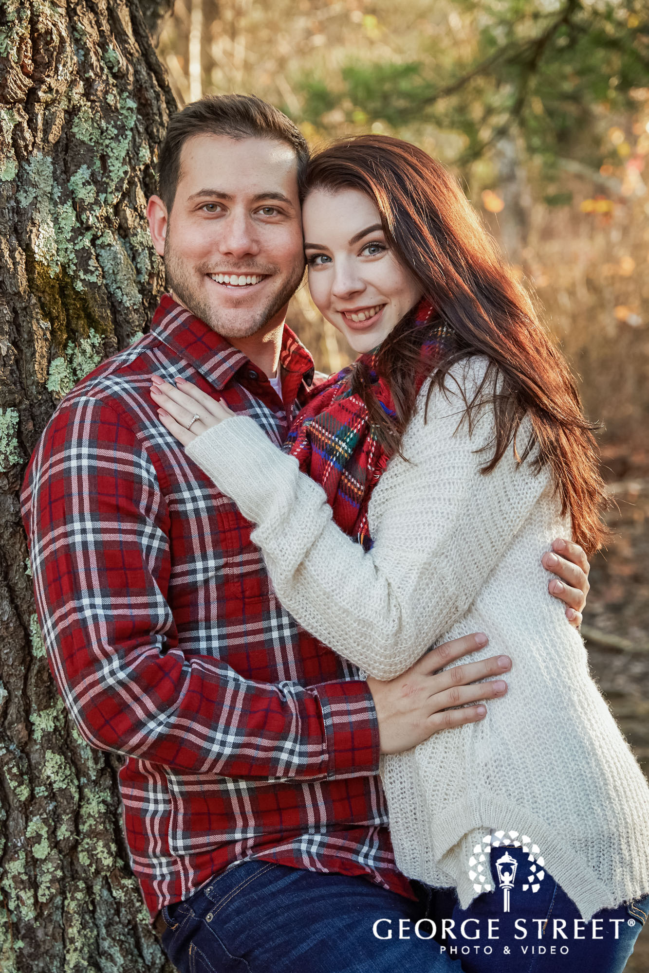 sweet couple in park engagement photo 2