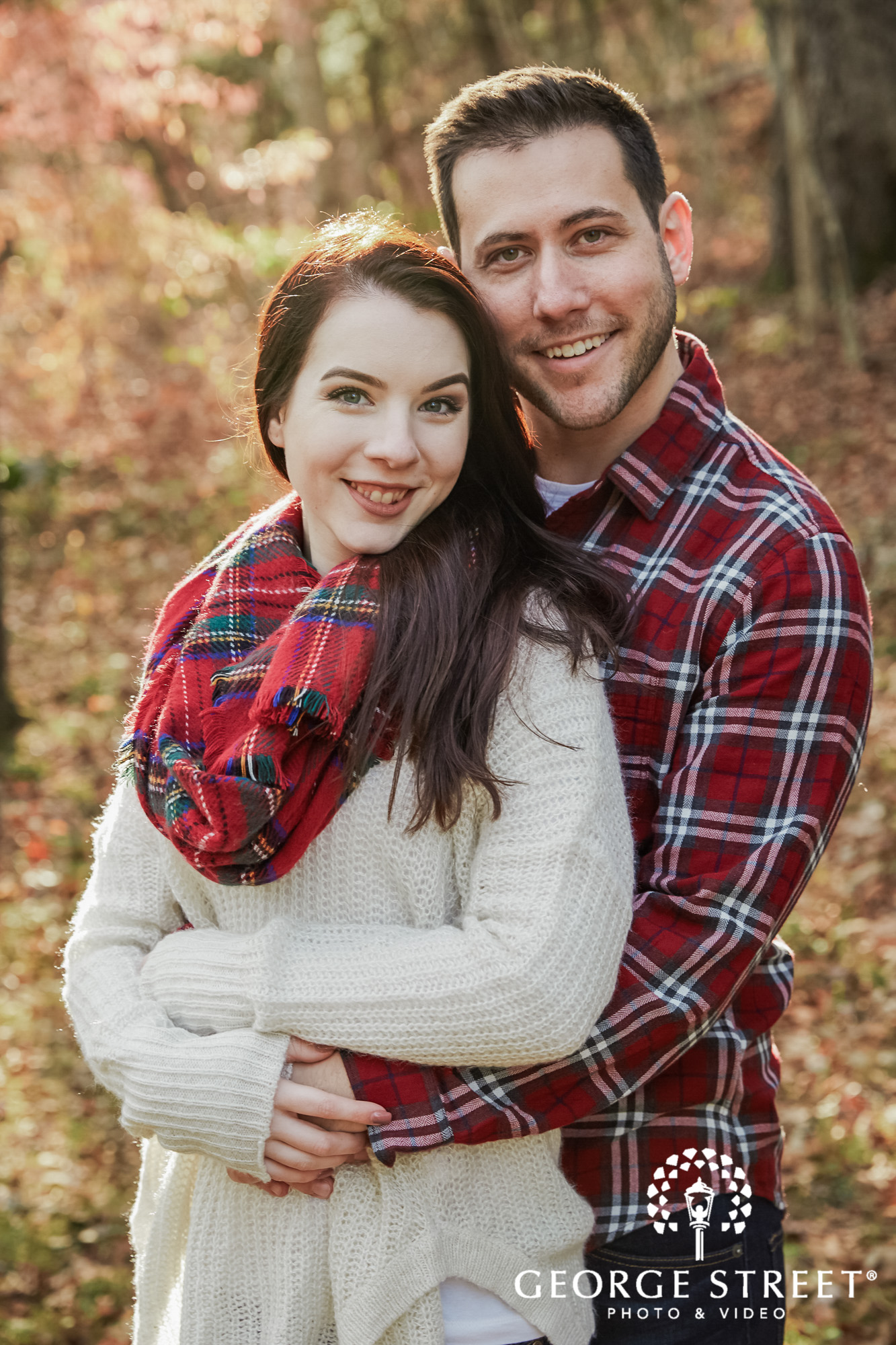 sweet couple in park engagement photo