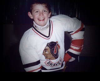 A young Jason Spezza in his Braves jersey.