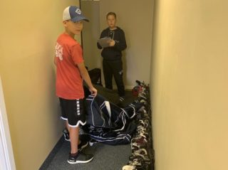 The Terriers organizing equipment donations.