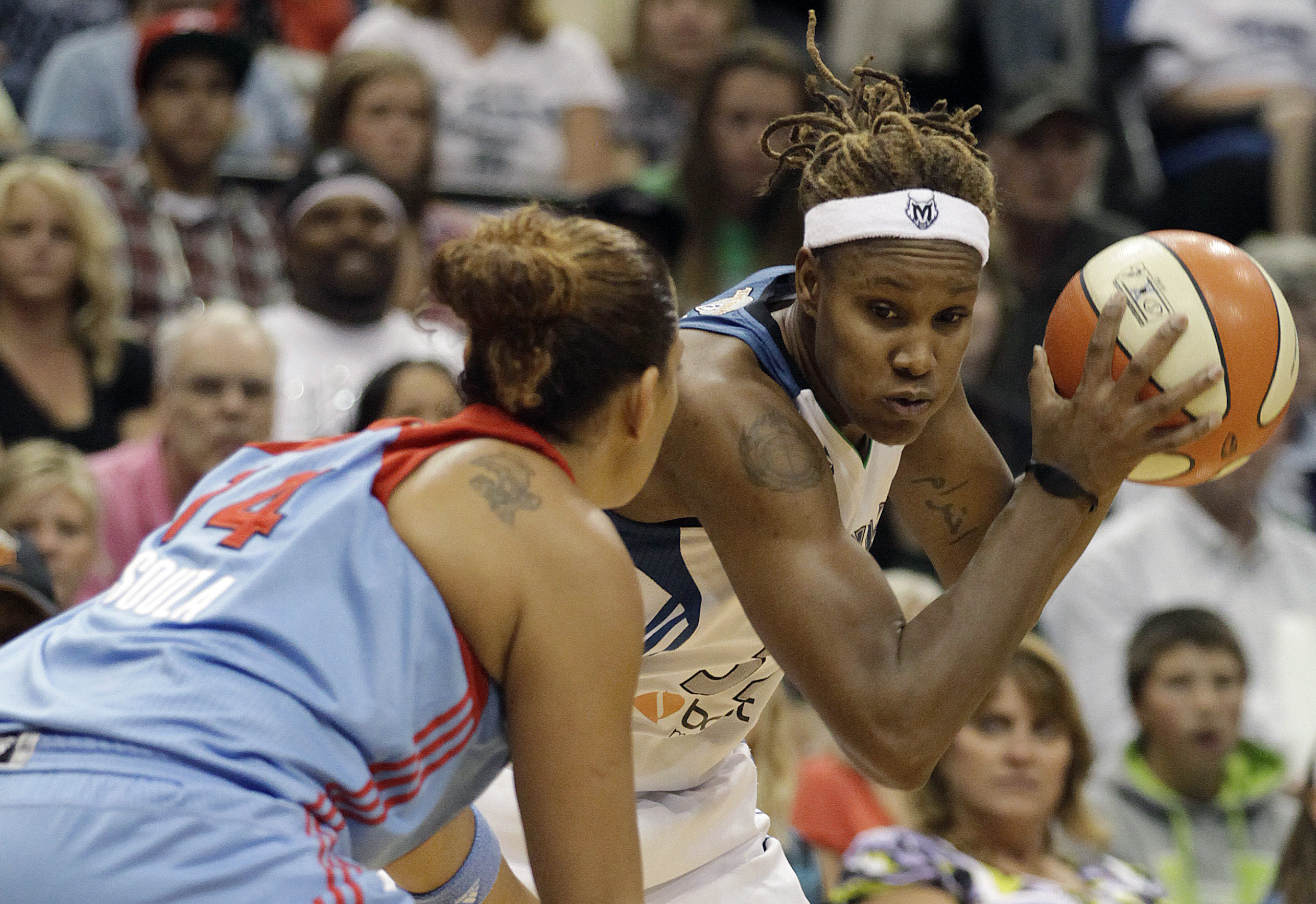Minnesota Lynx forward Rebekkah Brunson, right, protects the ball against Atlanta Dream forward Erika de Souza (14) in the second half of Game 2 of the WNBA Finals basketball series, Wednesday, Oct. 5, 2011, in Minneapolis. The Lynx won 101-92. (AP Photo/Stacy Bengs