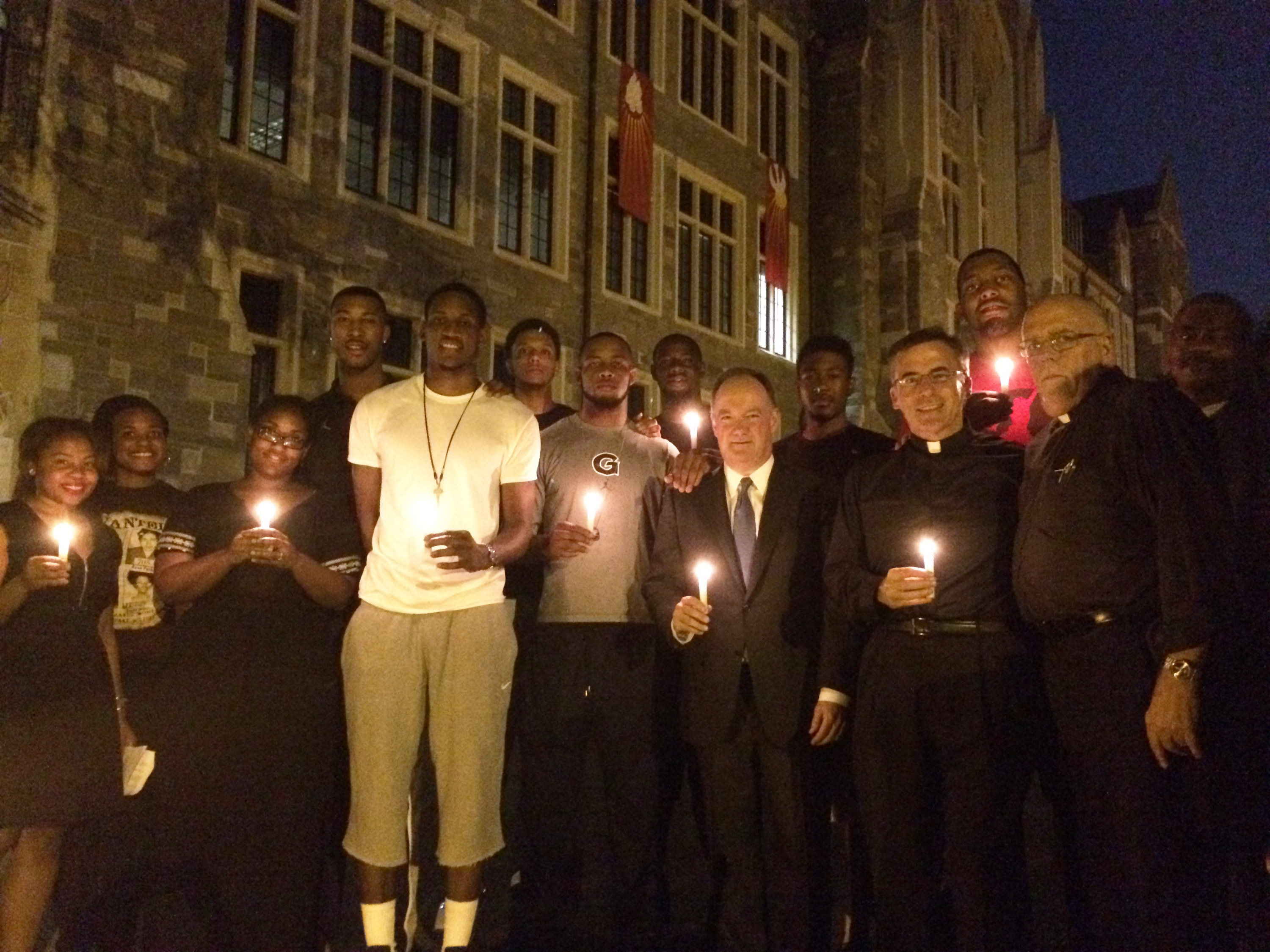Members of the Georgetown men's basketball team attended a candlelight vigil hosted by the Black Leadership Forum on Tuesday night to remember slain Missouri teen Michael Brown.