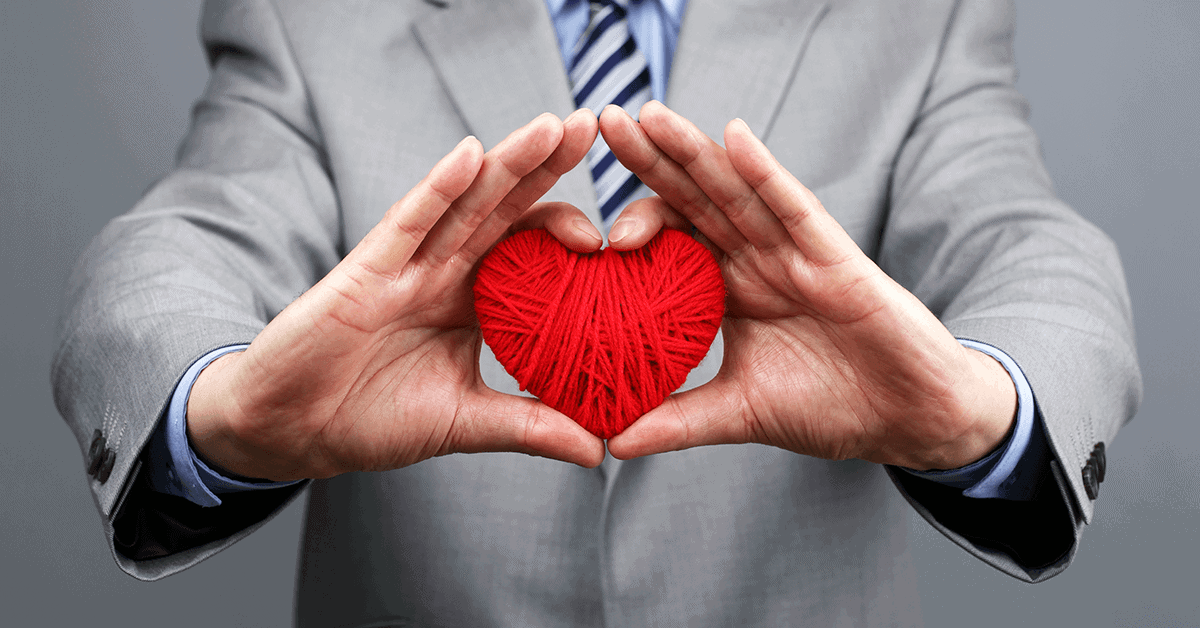 Businessman holding a yarn heart