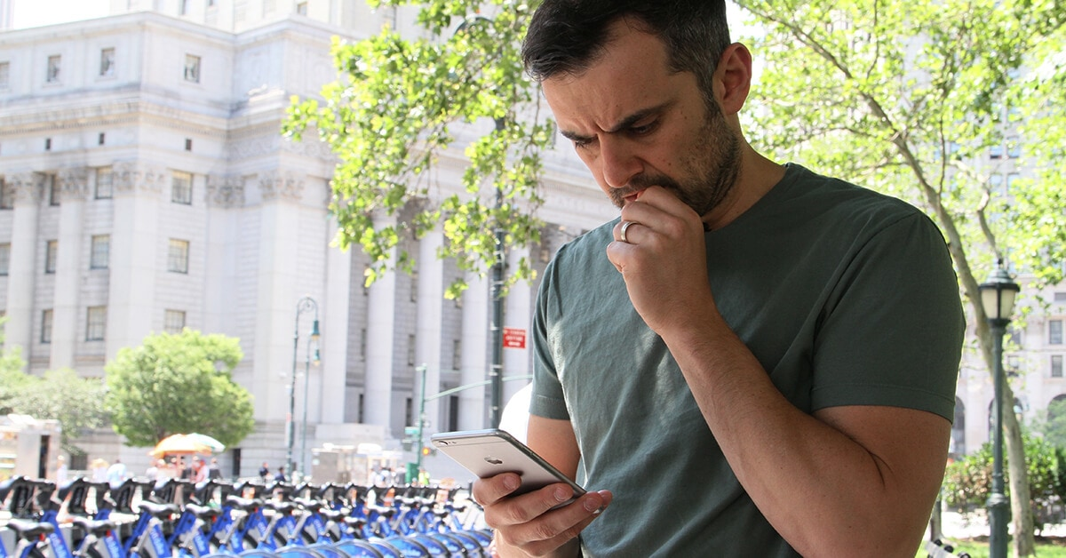 Gary Vaynerchuk reads an email on his phone