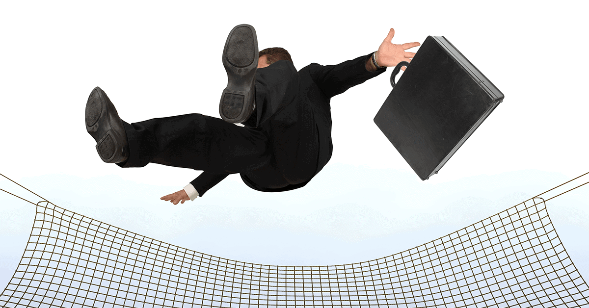 businessman falling into a safety net
