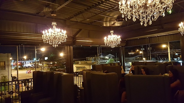 Chandeliers above the outdoor seating. Photo credit: Happenin's in the 'Ham