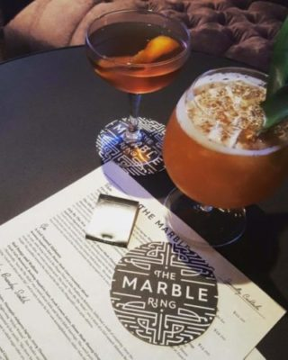 Marble ring glass Cocktails and Menu. Photo Credit: @themarblering on Instagram