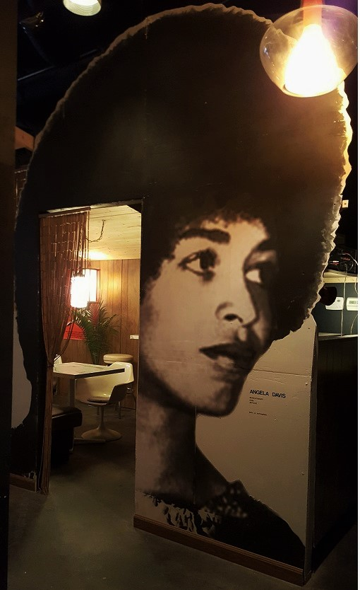Angela Davis looking fierce! Entrance to the private room at the Atomic Lounge.