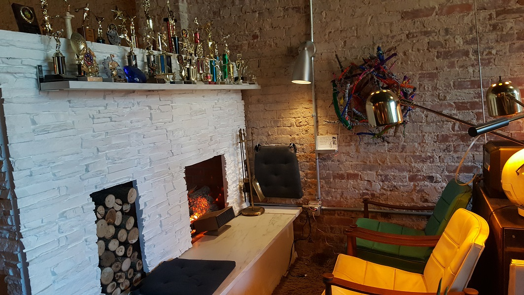 Atomic Lounge Fireplace with trophies! Bring yours from home!