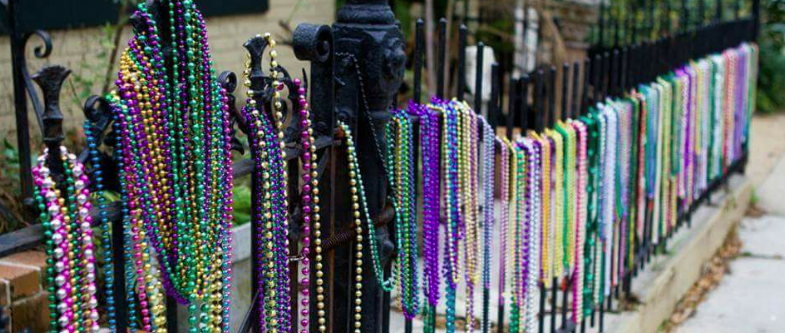 Mardi Gras Beads on a Fence