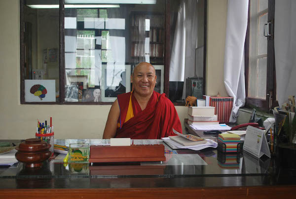 Geshe Lhakdor at his desk. Credit: The Tibet Post